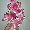 Baby corsages start at $17.50. Pictured is $25.00